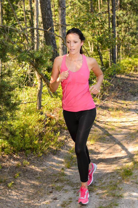 woman-running-in-the-woods