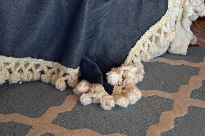 I love the texture of a chunky pompom throw and wanted one to cozy up the  guest bed 8d4408e21
